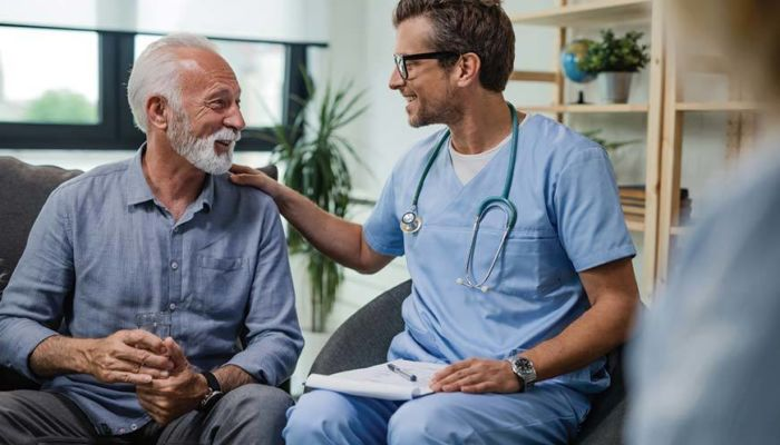 Doctor reassuring patient friendly like family