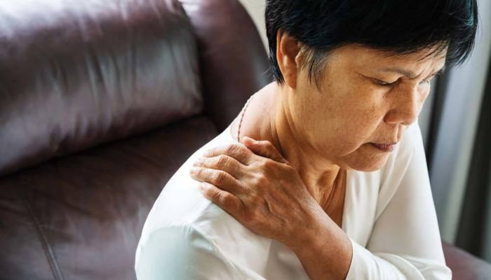 Elderly woman with back pain thoracic outlet