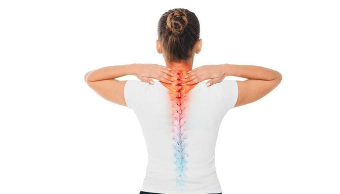 Woman touching back of neck with spine graphic showing