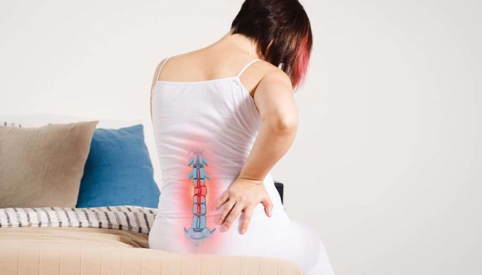 Woman with back pain spine image showing on shirt